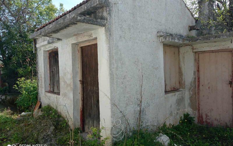 Big land with cottages to renovate close to Panormos beach small cottage