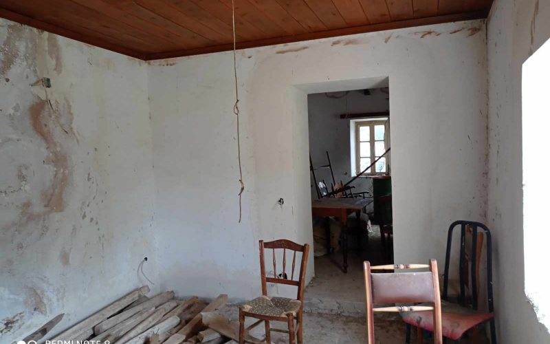 Big land with cottages to renovate close to Panormos beach Big cottage