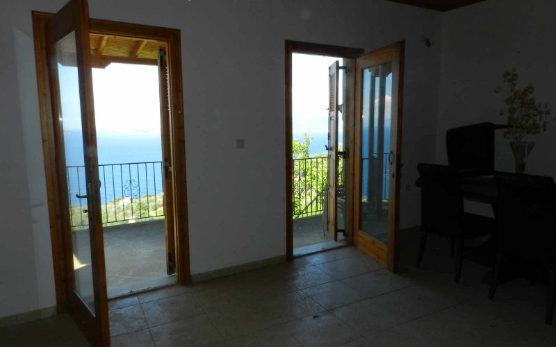 Property with Sea views in Glossa village Living room with balcony